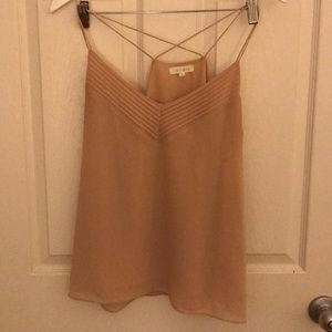 Blush colored tank top. 100 poly. Great condition.